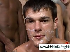 Gay guy sucks big cocks while getting fucked then gets a facial