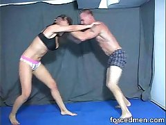 Big titted mistress in bikini wrestles against a horny wet blanket