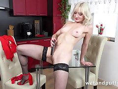 Sexy blonde in stockings pleases herself surrounding dildo