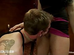 Bondage boy gives oral pleasure on brunette tranny