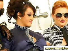 Glamouors clothed lesbo sluts get bukkake from plastic cocks