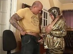 Old woman strips and get fucked away from younger guy
